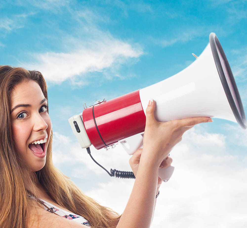 portrait of a girl shouting with a megaphone