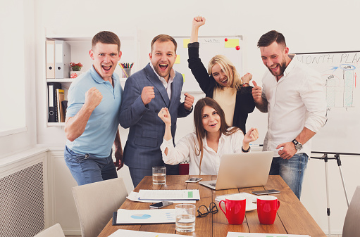 Happy business people team celebrate success in the office